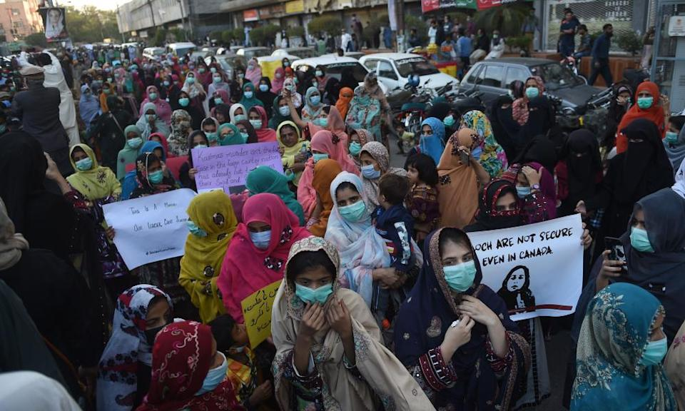Protesters attend a demonstration on 24 December in Karachi, Pakistan, after human rights activist Karima Baloch was found dead in Canada.