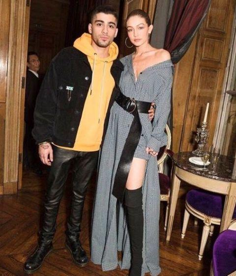 <p>In a grey, off-the-shoulder Adam Selman dress and belt with thigh-high Tony Bianco boots and Jennifer Fisher hoop earrings while out with Zayn Malik in Paris. </p>