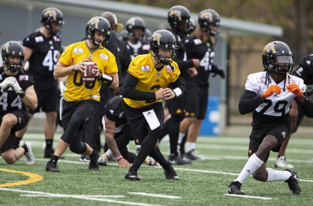 The newest addition to the Canadian Football League Hamilton Tiger-Cats roster, quarterback Johnny Manziel (2) works during Tiger Cats training camp in Hamilton, Ontario on Sunday, May 20, 2018. Heisman Trophy winner Manziel signed a two-year contract with the Hamilton Tiger-Cats on Saturday, looking to salvage his football career after a turbulent and unsuccessful stay with the Cleveland Browns. (Peter Power/The Canadian Press via AP)