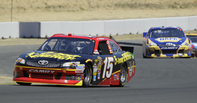 Clint Bowyer, left, and Martin Truex Jr., right, make their way up Turn 2 during the NASCAR Sprint Cup Series auto race, Sunday, June 24, 2012, in Sonoma, Calif. (AP Photo/Eric Risberg)