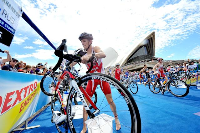 SYDNEY, AUSTRALIA - APRIL 14: In this handout photo provided by the International Triathlon Union, 2000 Sydney Olympic Games gold medallist Simon Whitfield of Canada grabs his bike in the first transition during the opening round of the 2012 ITU World Triathlon Series on April 14, 2012 in Sydney, Australia. (Photo by ITU via Getty Images)