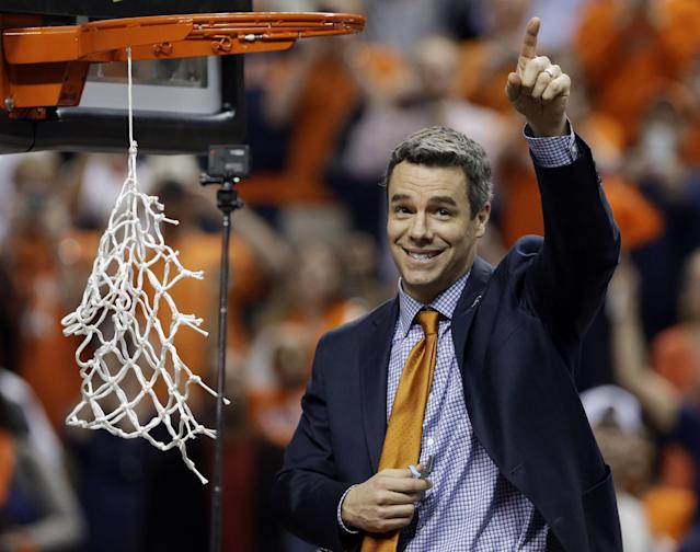 FILE - In this March 16, 2014, file photo, Virginia coach Tony Bennett celebrates after Virginia defeated Duke in an NCAA college basketball game for the championship of the Atlantic Coast Conference men's tournament in Greensboro, N.C. Coming off the program's best season in decades, Virginia announced Tuesday, June 3, 2014, that Bennett has signed a new seven-year contract that will keep him courtside with the Cavaliers through the 2020-21 season. (AP Photo/Gerry Broome, File)