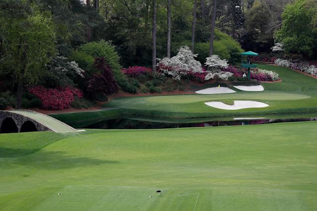 """<div class=""""caption""""> A view of the 12th hole at Augusta National Golf Club. </div> <cite class=""""credit"""">Kevin C. Cox/Getty Images</cite>"""