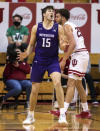 Northwestern center Ryan Young (15) reacts after being called for a foul during the second half of the team's NCAA college basketball game against Indiana, Wednesday, Dec. 23, 2020, in Bloomington, Ind. (AP Photo/Doug McSchooler)