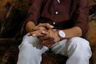 A typhoid fever survivor talks with Reuters at his family home in Karachi,