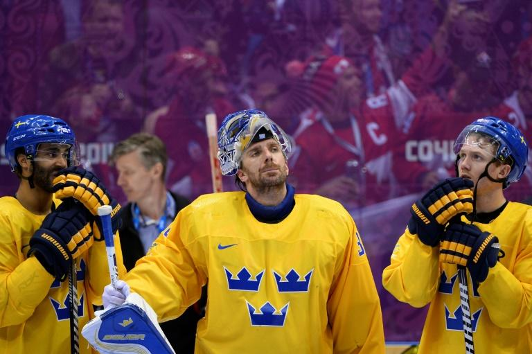 Sweden's silver medallist Henrik Lundqvist (centre) reacts during the Men's Ice Hockey Medal Ceremony at the Bolshoy Ice Dome during the Sochi Winter Olympics on February 23, 2014