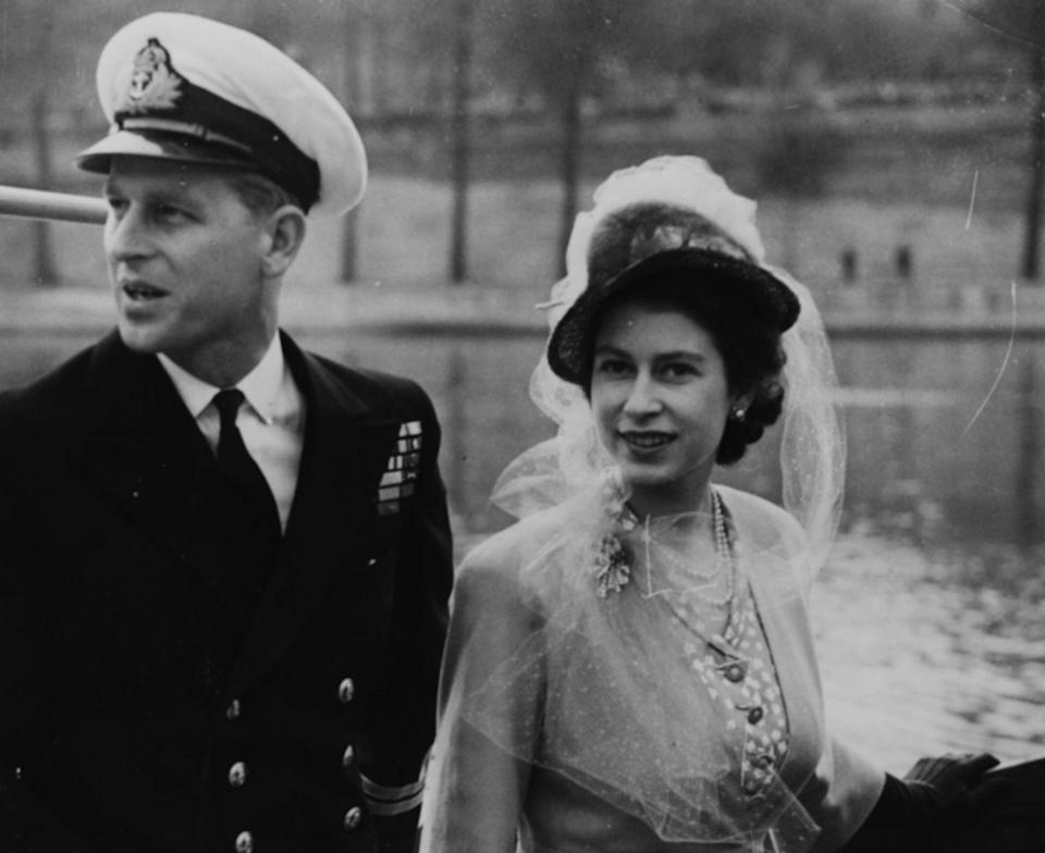 <p>The royal couple boards a boat on the Seine River during a visit to Paris in the spring of 1948. </p>