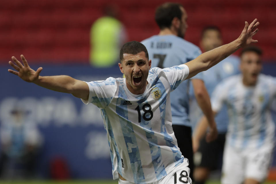Argentina's Guido Rodriguez celebrates after scoring his side's opening goal against Uruguay during a Copa America soccer match at the National Stadium in Brasilia Brazil, Friday, June 18, 2021. (AP Photo/Eraldo Peres)