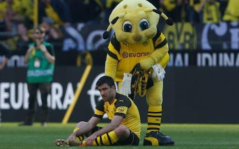 Arsenal have reached an agreement to sign Greek centre-back Sokratis Papastathopoulos from Borussia Dortmund, their third new arrival of 2018 to have played for the Bundesliga club. Head of recruitment Sven Mislintat, who Arsenal poached from Dortmund, seems to be following the old adage that it is better the devil you know while settling into his new job. Sokratis - as he is known, mercifully - will be the second purchase of the Unai Emery-era. However, Arsenal's buying strategy is no longer determined by the whims of their manager. The club's interest in Sokratis predates Emery's appointment, with Mislintat, chief executive Ivan Gazidis and head of football relations Raul Sanllehi identifying targets for their new head coach to rubber stamp. So why have this new team of decision-makers settled on Sokratis and what can Arsenal fans expect from their new defender? His career so far... AEK Athens were Sokratis' first professional club in Greece and it was there he learned his trade before a £3.4 million move to Genoa. An impressive first two seasons in Serie A attracted the attention of AC Milan who signed him in 2010 but sold him back to Genoa a year later. After a season on loan in Germany, Werder Bremen completed the permanent signing of Sokratis in 2012 before Dortmund - then managed by Jurgen Klopp - came in for him the following summer. Mats Hummels and Neven Subotic were very much ahead in the pecking order, but the 29-year-old began to establish himself under Thomas Tuchel and was a regular in Dortmund's excellent 2015-16 campaign. Since Tuchel's departure, Sokratis has endured some rough patches, though Dortmund as a unit have been beset by defensive problems. Gunnersaurus might be playing this part next season Credit: Reuters What type of defender is he? Very much a front-footed centre-back, Sokratis prefers to win the ball early with robust challenges rather than sprint back with opponents and defend on the back foot. When this approach pays dividends, the