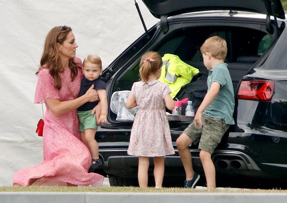 WOKINGHAM, UNITED KINGDOM - JULY 10: (EMBARGOED FOR PUBLICATION IN UK NEWSPAPERS UNTIL 24 HOURS AFTER CREATE DATE AND TIME) Catherine, Duchess of Cambridge, Prince Louis of Cambridge, Princess Charlotte of Cambridge and Prince George of Cambridge attend the King Power Royal Charity Polo Match, in which Prince William, Duke of Cambridge and Prince Harry, Duke of Sussex were competing for the Khun Vichai Srivaddhanaprabha Memorial Polo Trophy at Billingbear Polo Club on July 10, 2019 in Wokingham, England. (Photo by Max Mumby/Indigo/Getty Images)