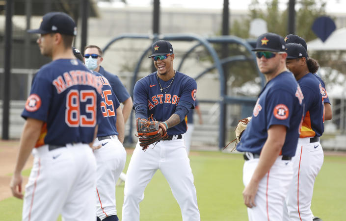 Houston Astros pitcher Bryan Abreu (66) laughs with other pitchers during spring training baseball in West Palm Beach, Fla., Monday, Feb. 22, 2021. (Karen Warren/Houston Chronicle via AP)