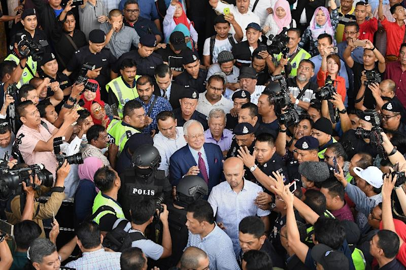 Former Malaysian prime minister Najib Razak (C) says the trial is 'the best way to clear my name' (AFP Photo/MOHD RASFAN)