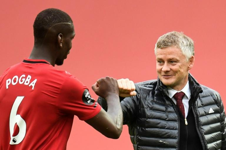 Ole Gunnar Solskjaer (right)is keen for Manchester United to extend Paul Pogba's (left) contract