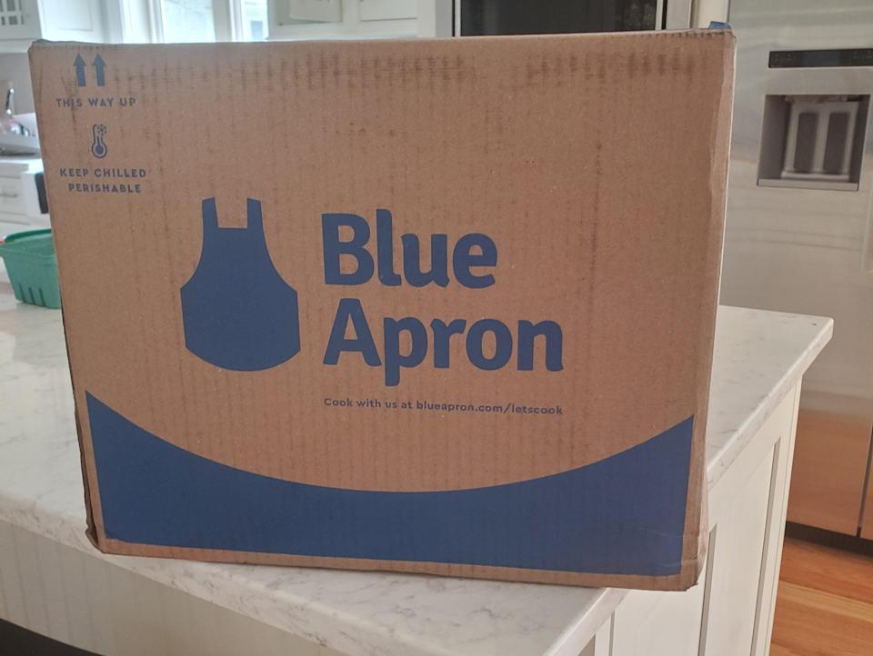 blue apron meal kit box on a kitchen counter