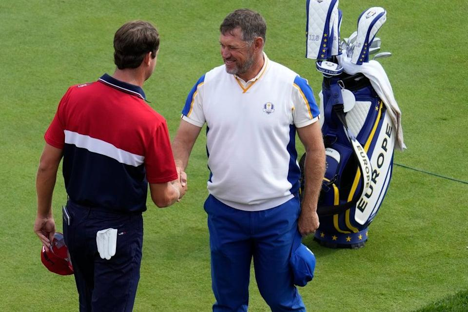 Lee Westwood shakes hands with Harris English after their singles match in the Ryder Cup (Ashley Landis/AP) (AP)