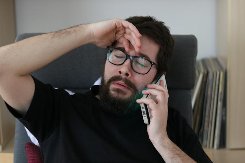 Depressed Man Crying while talking at the Phone
