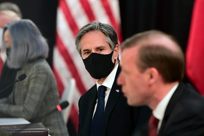 Secretary of State Antony Blinken, second from right, listens as national security adviser Jake Sullivan, right, speaks at the opening session of US-China talks at the Captain Cook Hotel in Anchorage, Alaska, Thursday, March 18, 2021.
