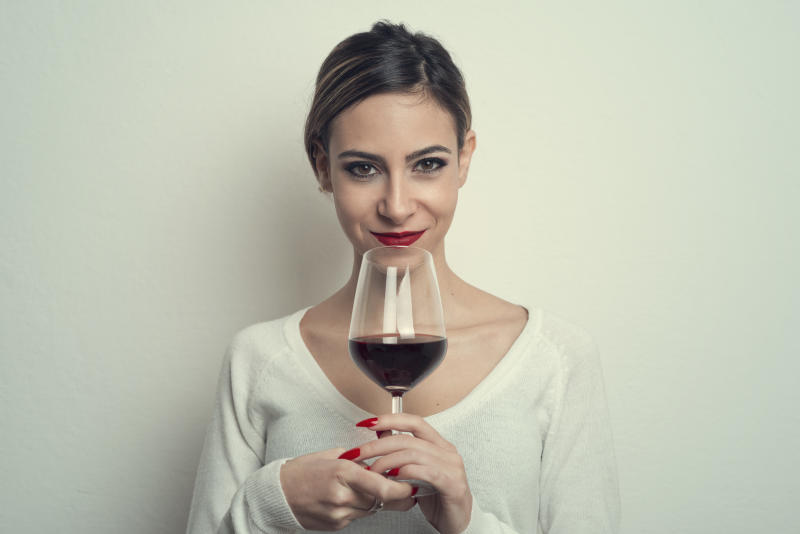 Portrait of Young Woman Holding Wineglass