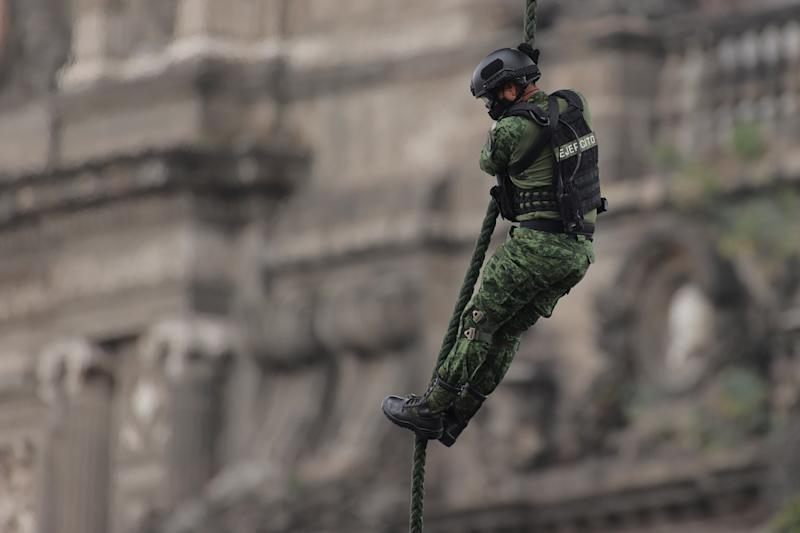 VARIOUS CITIES, MEXICO - SEPTEMBER 16: A Mexican Air Force soldier performs a ceremonial flight during the Independence Day military parade at Zocalo Square on September 16, 2020 in Various Cities, Mexico. This year El Zocalo remains closed for general public due to coronavirus restrictions. Every September 16 Mexico celebrates the beginning of the revolution uprising of 1810. (Photo by Hector Vivas/Getty Images)