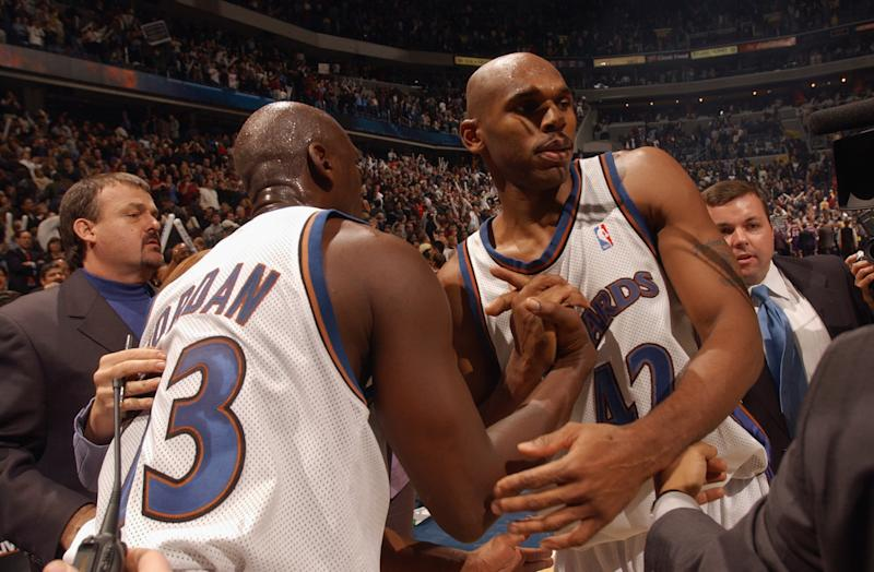 Jerry Stackhouse (right) of the Washington Wizards is congratulated by Michael Jordan (left) after his last second dunk that beat the Los Angeles Lakers at MCI Center on November 8, 2002, in Washington, D.C.