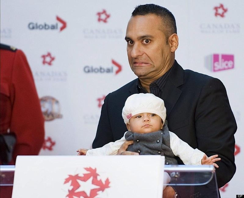 """Canada's king of stand-up comedy pulls no punches when it comes to his own dad, often sending audiences into fits of uncontrollable laughter with hilarious imitations of his Indian father. He recently became a father himself to Crystianna Marie, who was born prematurely and spent two months in the hospital. Luckily Peters' adorable daughter caught up quickly (he called her a <a href=""""http://www.youtube.com/watch?v=3fvrcUsq3X8"""" target=""""_hplink"""">'heifer' at 9 pounds</a>), and as this photo shows, he likes to incorporate her into his comedy. In 2011, she even made a cameo in his very first Christmas special."""