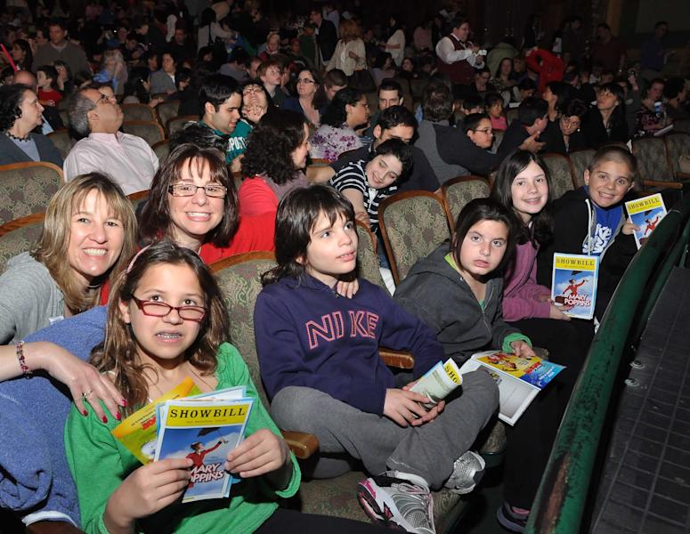 """In this April 29, 2012 photo released by the Theatre Development Fund, kids attend at an autism-friendly performance of the musical """"Mary Poppins, in New York. About 40 autism specialists _ many master's students at Hunter College, special education experts or social workers _ roamed the theater, providing comfort and help to families. (AP Photo/Theatre Development Fund, Anita & Steve Shevett)"""