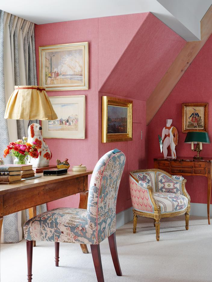 """<div class=""""caption""""> A seating area in the linen-wrapped master bedroom. Antique desk and armchair. </div> <cite class=""""credit"""">Simon Upton </cite>"""