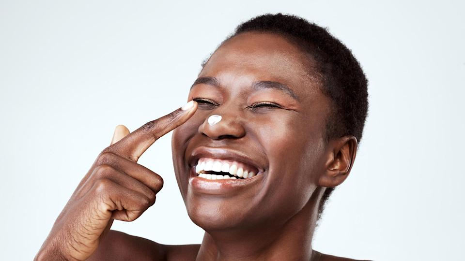 laughing woman with moisturiser on nose
