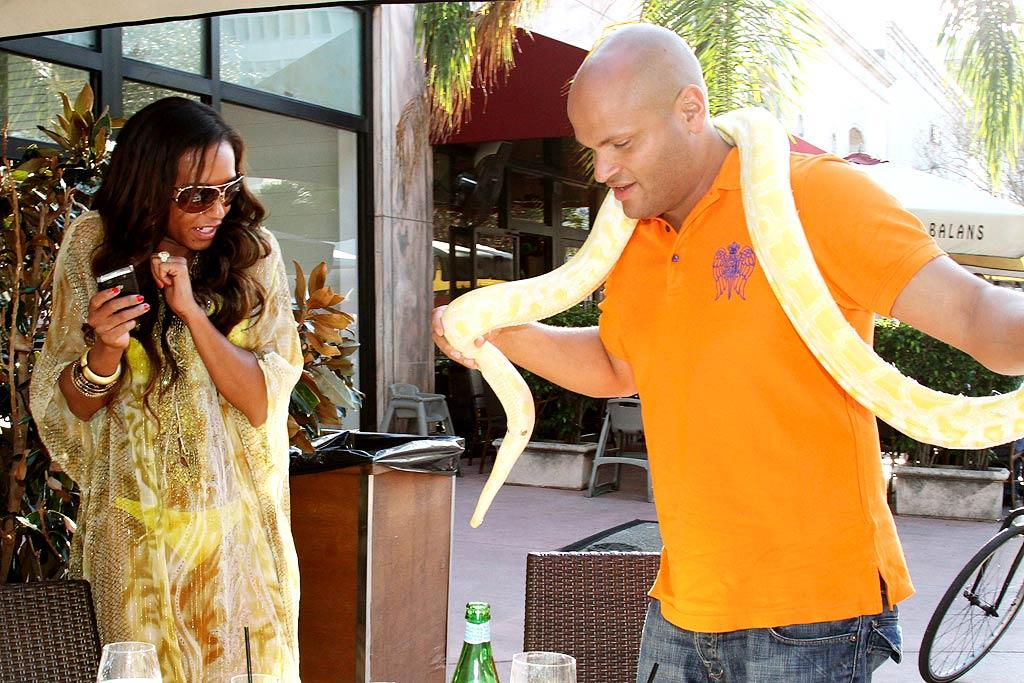 "Not only did Melanie ""Scary Spice"" Brown decide to sport a bikini to a fancy Italian eatery in Miami (OK, she covered up with a sheer golden caftan), but hubby Stephen Belafonte agreed to let a boa constrictor join them for lunch as well! Pichichi/<a href=""http://www.splashnewsonline.com/"" target=""new"">Splash News</a> - March 23, 2010"