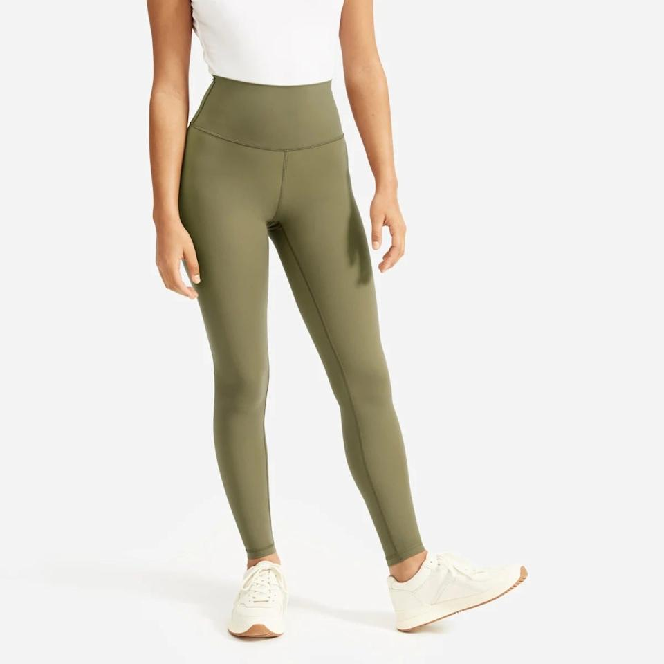 """<h3><a href=""""https://www.everlane.com/products/womens-perform-legging-lichen"""" rel=""""nofollow noopener"""" target=""""_blank"""" data-ylk=""""slk:Everlane The Perform Legging"""" class=""""link rapid-noclick-resp"""">Everlane The Perform Legging</a></h3><br>Ever since Everlane's sustainably made leggings first debuted earlier this month — and our <a href=""""https://www.refinery29.com/en-us/2020/01/9213127/everlane-perform-legging-review"""" rel=""""nofollow noopener"""" target=""""_blank"""" data-ylk=""""slk:Beauty & Wellness writer gave them one glowing review"""" class=""""link rapid-noclick-resp"""">Beauty & Wellness writer gave them one glowing review</a> — the recycled nylon and elastane blend has continued to trend as the top-purchased activewear material of 2020.<br><br><strong>Everlane</strong> The Perform Legging in Lichen, $, available at <a href=""""https://www.everlane.com/products/womens-perform-legging-lichen?collection=womens-perform-leggings"""" rel=""""nofollow noopener"""" target=""""_blank"""" data-ylk=""""slk:Everlane"""" class=""""link rapid-noclick-resp"""">Everlane</a>"""