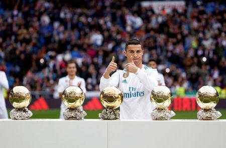 FILE PHOTO: Soccer Football - La Liga Santander - Real Madrid vs Sevilla - Santiago Bernabeu, Madrid, Spain - December 9, 2017 Real Madrid's Cristiano Ronaldo with his five Ballon d'Or trophies before the match REUTERS/Javier Barbancho