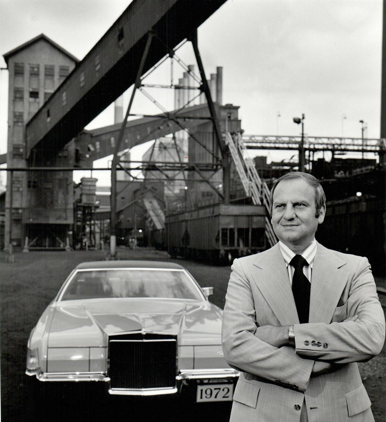 Lee Iacocca, as a young man, is already president of the Ford Motor Company, shown here in front of the River Rouge Plant in 1971.