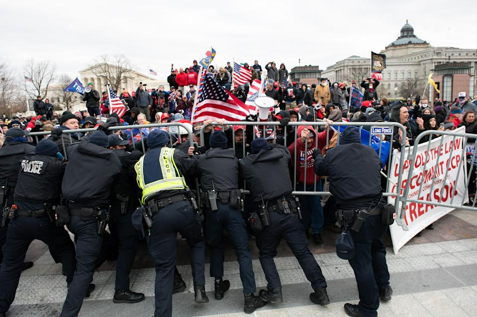 Capitol Police struggle to keep rioters at bay outside the United States Capitol building, January 6, 2021.