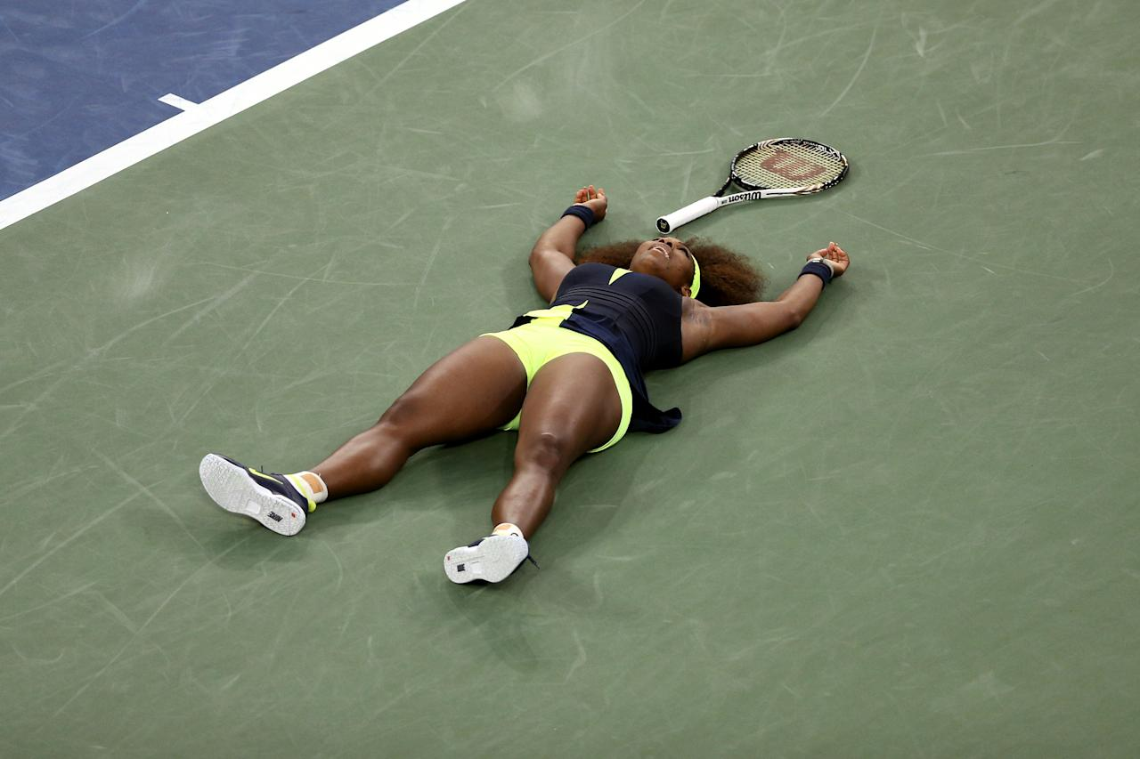 NEW YORK, NY - SEPTEMBER 09:  Serena Williams of the United States celebrates match point after defeating Victoria Azarenka of Belarus to win the women's singles final match on Day Fourteen of the 2012 US Open at USTA Billie Jean King National Tennis Center on September 9, 2012 in the Flushing neighborhood of the Queens borough of New York City.  (Photo by Clive Brunskill/Getty Images)