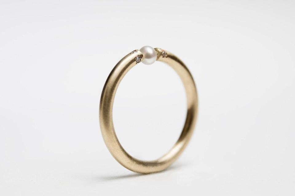 <p>This <span>Gold Pearl And Diamonds Engagement Ring</span> ($464 and up) features an industrial look for minimalist brides.</p>