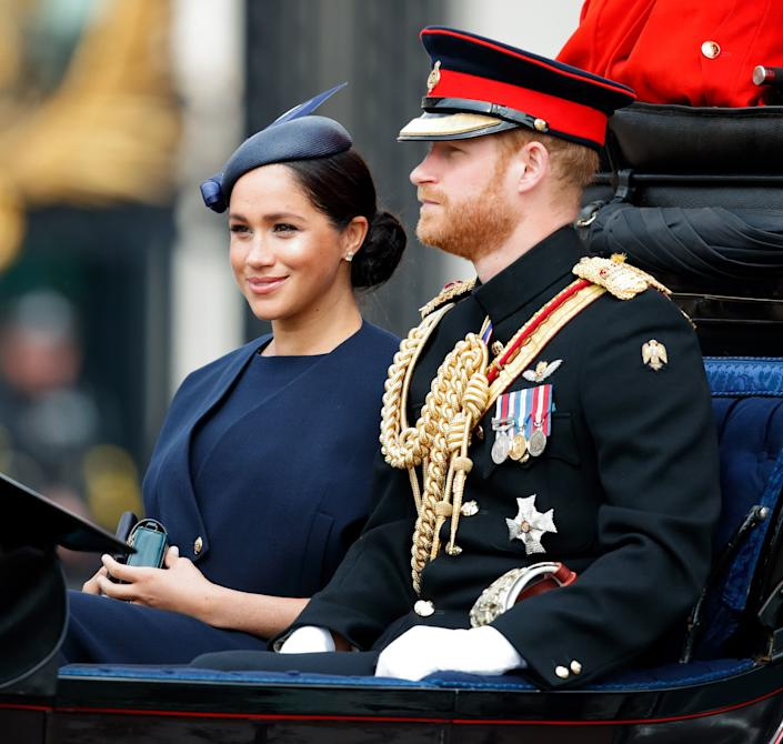 Meghan and Harry in a horse-drawn carriage during Trooping the Color, the Queen's annual birthday parade, in London.