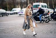 """<p>Versatile, practical and lightweight to layer, the best trench <a href=""""https://www.harpersbazaar.com/uk/fashion/what-to-wear/news/g37285/best-camel-coats/"""" rel=""""nofollow noopener"""" target=""""_blank"""" data-ylk=""""slk:coats"""" class=""""link rapid-noclick-resp"""">coats</a> are more than transitional heroes: they'll see you through almost every situation, in any season.</p><p>Audrey Hepburn in Breakfast at Tiffany's, Meryl Streep in Kramer Vs Kramer or Kate Moss in countless Burberry campaigns – the trench <a href=""""https://www.harpersbazaar.com/uk/fashion/what-to-wear/news/g32335/best-fall-winter-coats/"""" rel=""""nofollow noopener"""" target=""""_blank"""" data-ylk=""""slk:coat"""" class=""""link rapid-noclick-resp"""">coat</a> has been in en vogue for over a century. And, despite being created for military purposes back in 1912, its appeal has lasted through decades of different dress codes. Because, thrown over everything from jeans and a Breton top to slinky evening dresses, its functionality immediately translates to effortlessness (a look more coveted than any It bag).<br></p><p>The wardrobe staple hasn't changed much in that time. So you can still find heavy cotton-gabardine numbers with the trademark storms flaps, buckles and and belting everywhere from Off-White to Arket. However, with so many re-interpretations debuting on the catwalk every season, it's hard not to be tempted by fresh styles. At the <a href=""""https://www.harpersbazaar.com/uk/fashion/shows-trends/g35506534/autumn-winter-2021-fashion-shows/"""" rel=""""nofollow noopener"""" target=""""_blank"""" data-ylk=""""slk:autumn/winter 2021 shows"""" class=""""link rapid-noclick-resp"""">autumn/winter 2021 shows</a>, trenches were tailored to ladylike perfection at Erdem, panelled with quilted satin at Chloé, and re-worked in glossy vinyl and gold metallics by Isabel Marant and Chanel.</p><p>Still, when you're spending money on a capsule classic, you need to think smart: invest in something with longevity, but don't be afraid of subtle twists or playful details. Fro"""