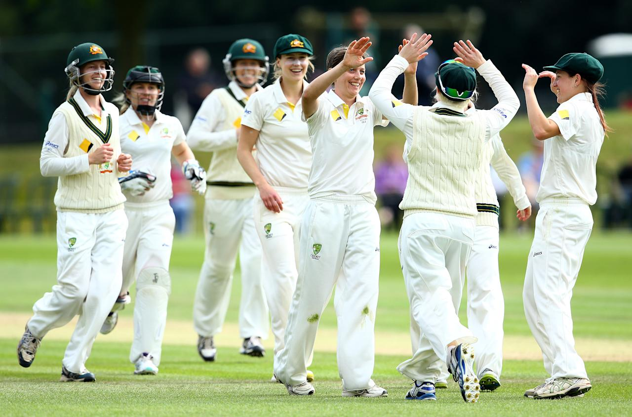 HIGH WYCOMBE, ENGLAND - AUGUST 14:   Sarah Elliott of Australia (C) celebrates the wicket of Arran Brindle of England with team mates during day four of the Women's Ashes Series match between England and Australia at Wormsley Cricket Ground on August 14, 2013 in High Wycombe, England.  (Photo by Jan Kruger/Getty Images)
