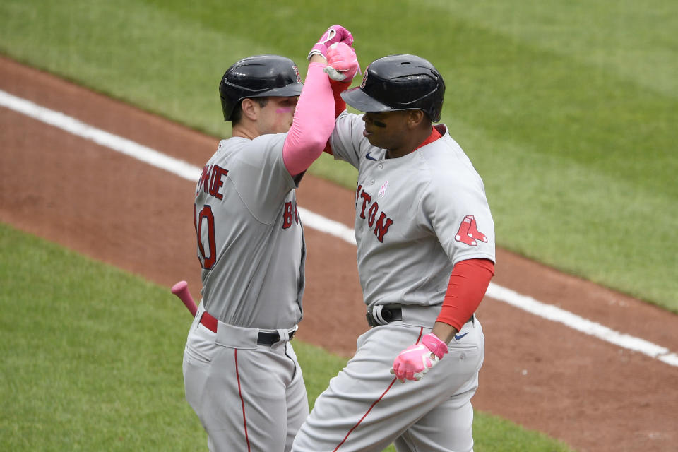 Boston Red Sox's Rafael Devers, right, celebrates his home run with Hunter Renfroe, left, during the second inning of a baseball game against the Baltimore Orioles, Sunday, May 9, 2021, in Baltimore. (AP Photo/Nick Wass)