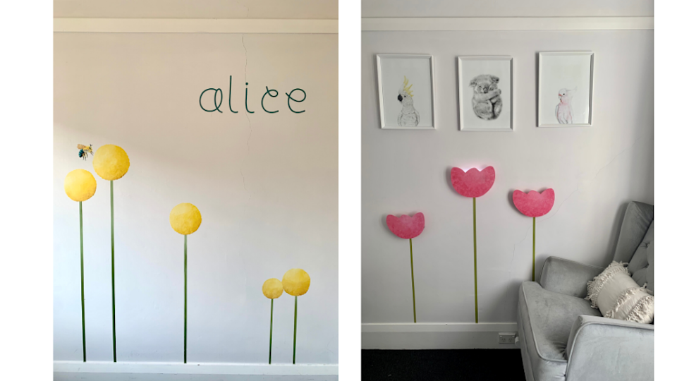 a kids bedroom with flowers on the wall made with a cricut