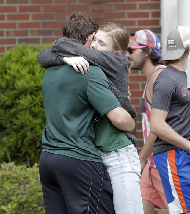 <p>Students hug outside a staging area at the First Baptist Church of Ocala after a shooting incident at nearby Forest High School, Friday, April 20, 2018, in Ocala, Fla. (Photo:John Raoux/AP) </p>