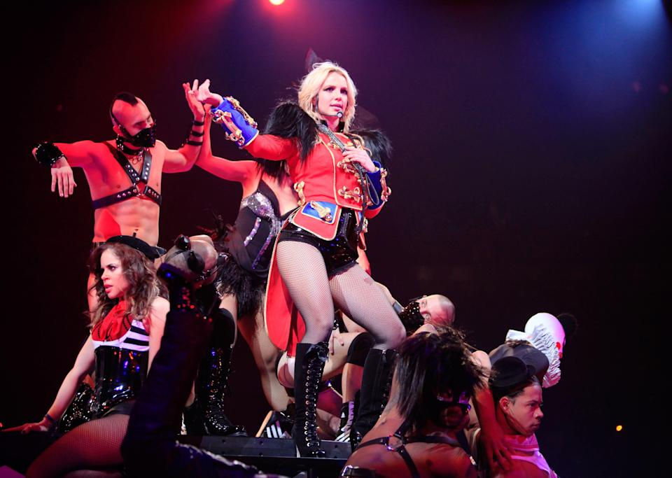 """Singer Britney Spears performs onstage during the opening night of """"The Circus Starring Britney Spears"""" tour. Her assistant was told by Jamie Spears she was not allowed to join the tour in Europe."""