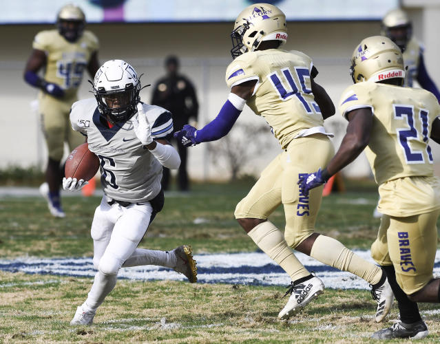 Jackson State wide receiver Warren Newman (6) attempts to avoid Alcorn State defensive backs Javen Morrison (45) and Juwan Taylor (21) during the first half of an NCAA college football game in Jackson, Miss., Saturday, Nov. 23, 2019. (Courtland Wells/The Vicksburg Post via AP)