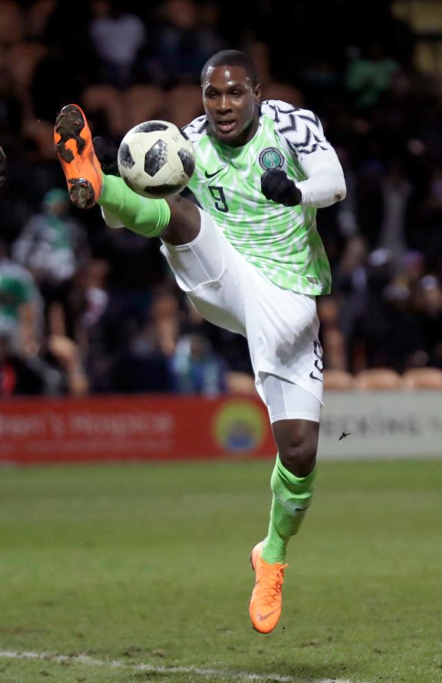 In this photo taken on Tuesday, March 27, 2018, Nigeria's Odion Ighalo reaches for the ball during the international friendly soccer match between Serbia and Nigeria at The Hive Stadium in London. (AP Photo/Matt Dunham)