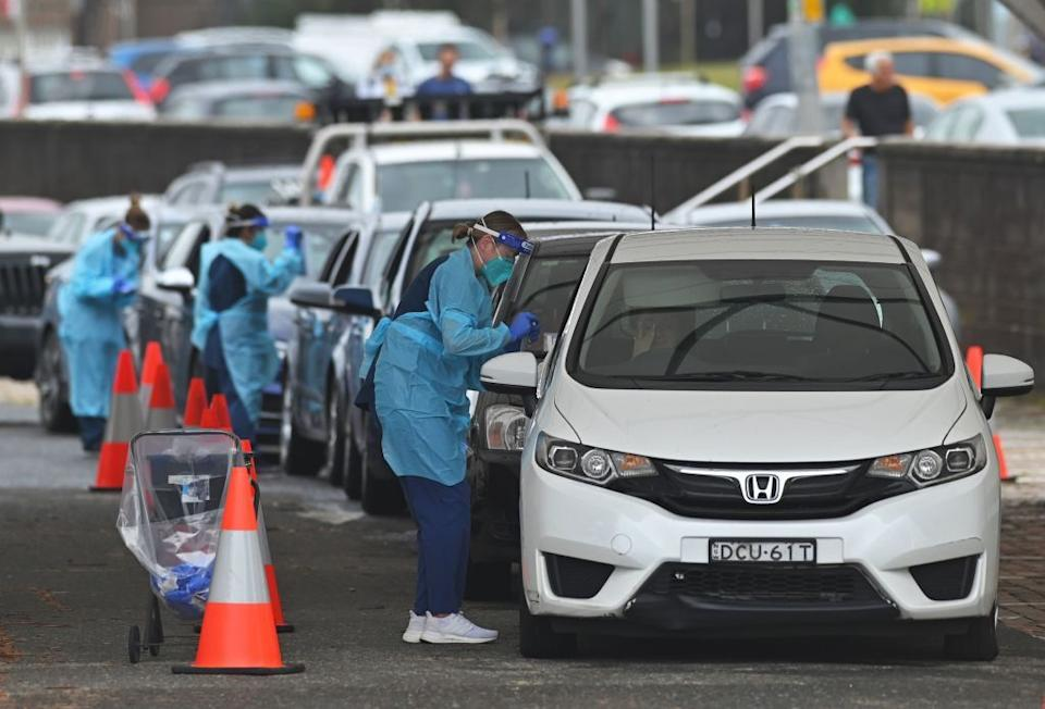 Health workers perform Covid-19 tests at a drive-through testing centre at Bondi Beach in Sydney.