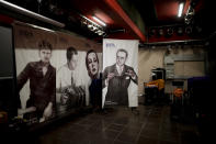 Posters of Argentine tango musicians, from right, Juan d'Arienzo, Tita Merello, Aníbal Troilo and Osvaldo Pugliese, decorate a stage at La Viruta Tango club, closed amid the COVID-19 pandemic in Buenos Aires, Argentina, Friday, June 4, 2021. Like other venues of its kind, the club has been closed since March 8, 2020, around the time that Argentine authorities decreed a strict quarantine in hopes of reducing the spread of COVID-19. (AP Photo/Natacha Pisarenko)