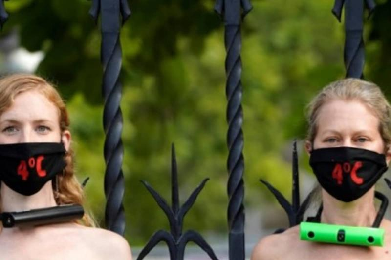 Topless Women Lock Themselves To Railing Outside UK Parliament to Protest Climate Change