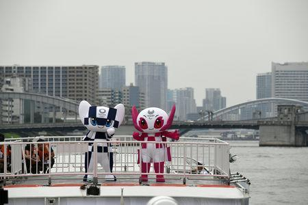 Tokyo 2020 Olympics Games mascots, Miraitowa and Someity ride on a boat during their debut event of water parade in Tokyo, Japan July 22, 2018. Toshifumi Kitamura/Pool via Reuters