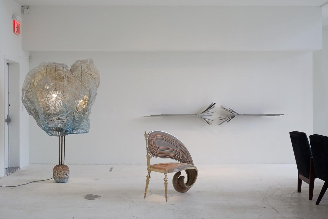 Floor Lamp: Blue Cocoon Concrete Base by Nacho Carbonell (2015). Bench: Fibonacci by Sebastian Brajkovic (2015). Wall sculpture: Doors I by Vincent Dubourg (2010). Chairs: Committee Armchair by Pierre Jeanneret (1960).