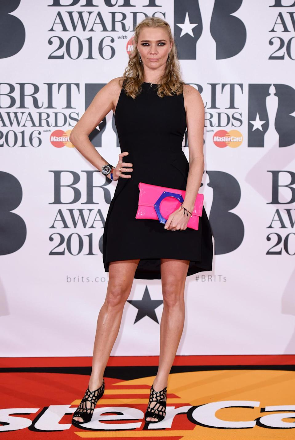 <p>Jodie also opted for a little black dress - and teamed it with a fun, colour-popping clutch. <i>[Photo: Rex]</i></p>